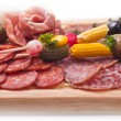 Board at restaurant with meat — Stock Photo #1276686