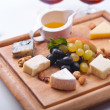 Various Types of Cheese with Honey Sauce - Stock Photo