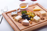 Various Types of Cheese with Honey Sauce — Stock Photo