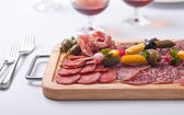 Board at restaurant with meat — Stock Photo