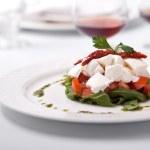 Dish tomatoes salad ruccola and cheese — Stock Photo