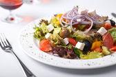 Greek salad on plate — Stock Photo