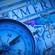 Compass on an ancient map America. - Stock Photo