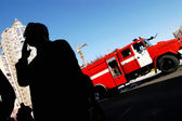 Man smoking in front of fire truck — Stock Photo