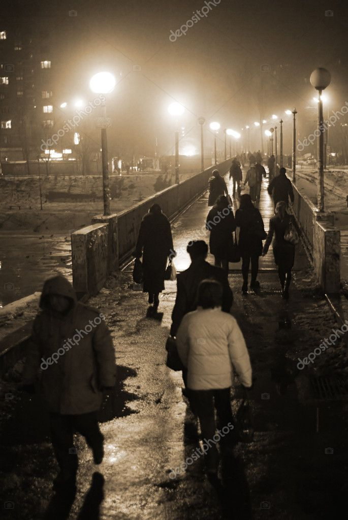 City commuters cross over the bridge in the foggy night — Stock Photo #2166341