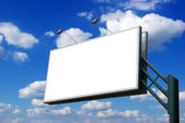 Advertising billboard on sky background — Stock Photo