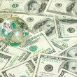 Globe on dollars — Stock Photo