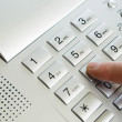 Finger with keypad - Stock Photo