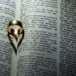 Ring on Bible — Stock Photo