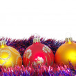 Foto Stock: Christmas tinsel and toys