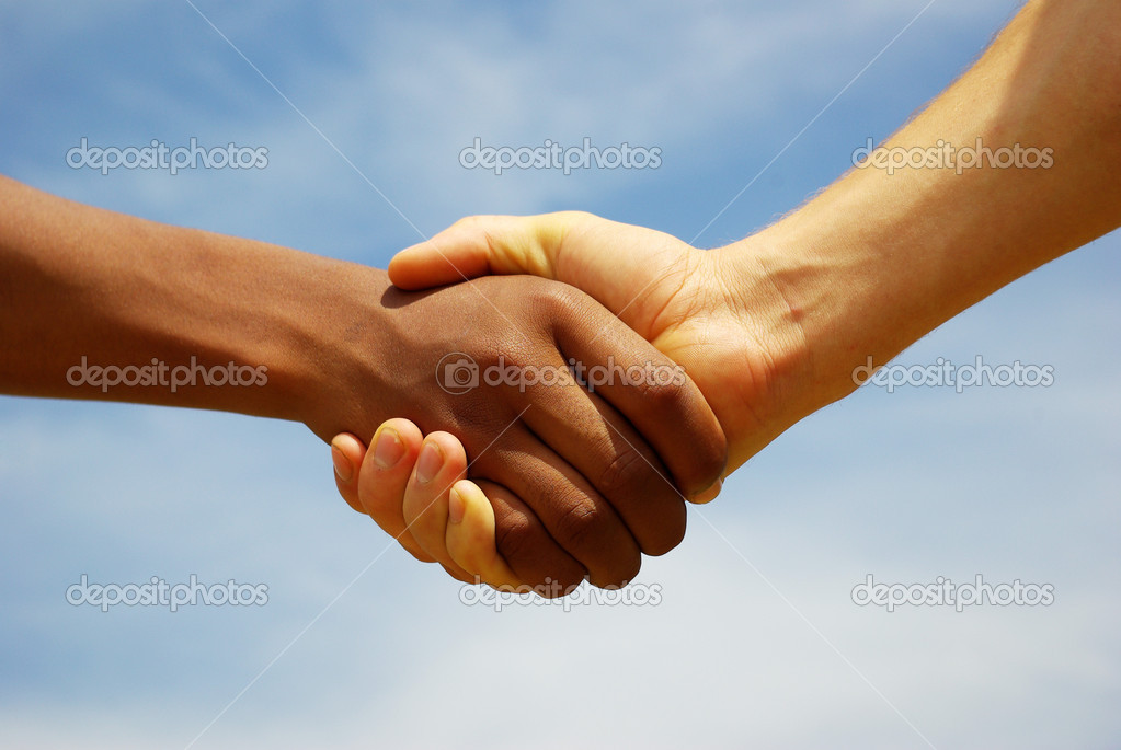 Two young businessmen shaking hands — Stock Photo #1624169