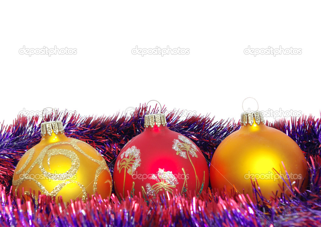 Christmas tinsel and toys on a white background  Foto Stock #1625224