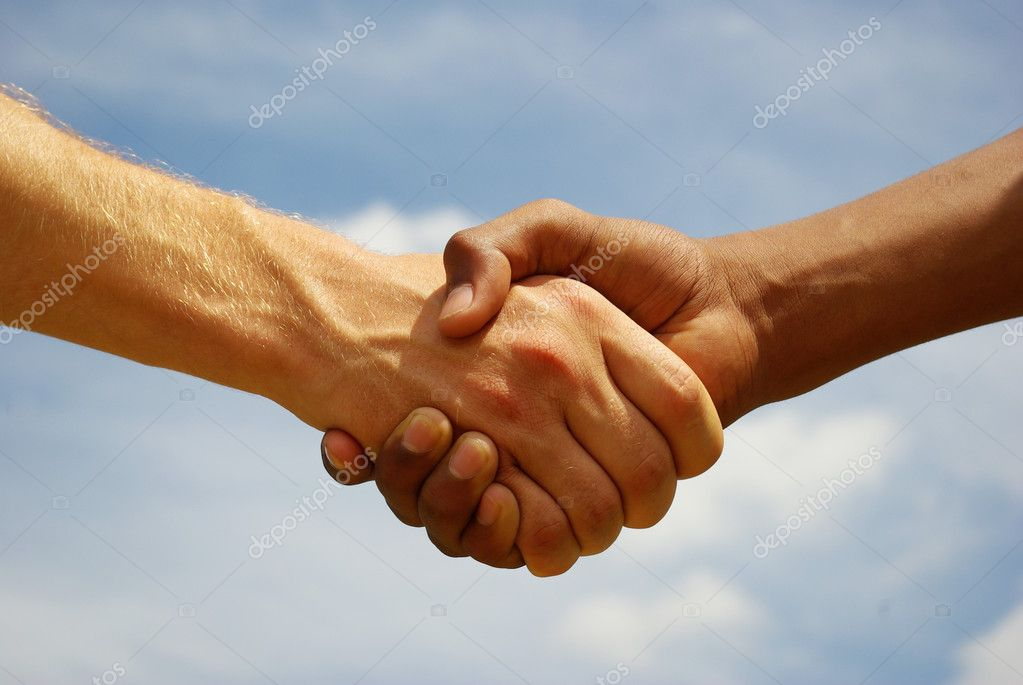 Two young businessmen shaking hands — Foto de Stock   #1628187