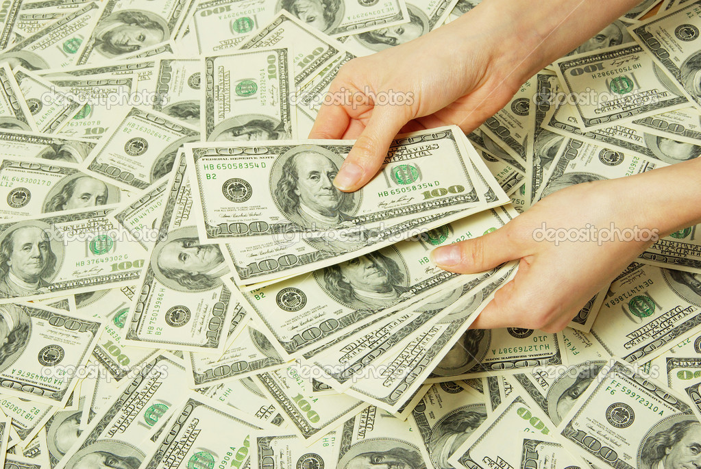 Hand with money isolated on money background — Stock Photo #2072662