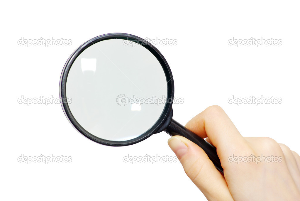 Hand holding a magnifying glass on white — Stock Photo #2072817