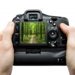 Camera in hand — Stock Photo