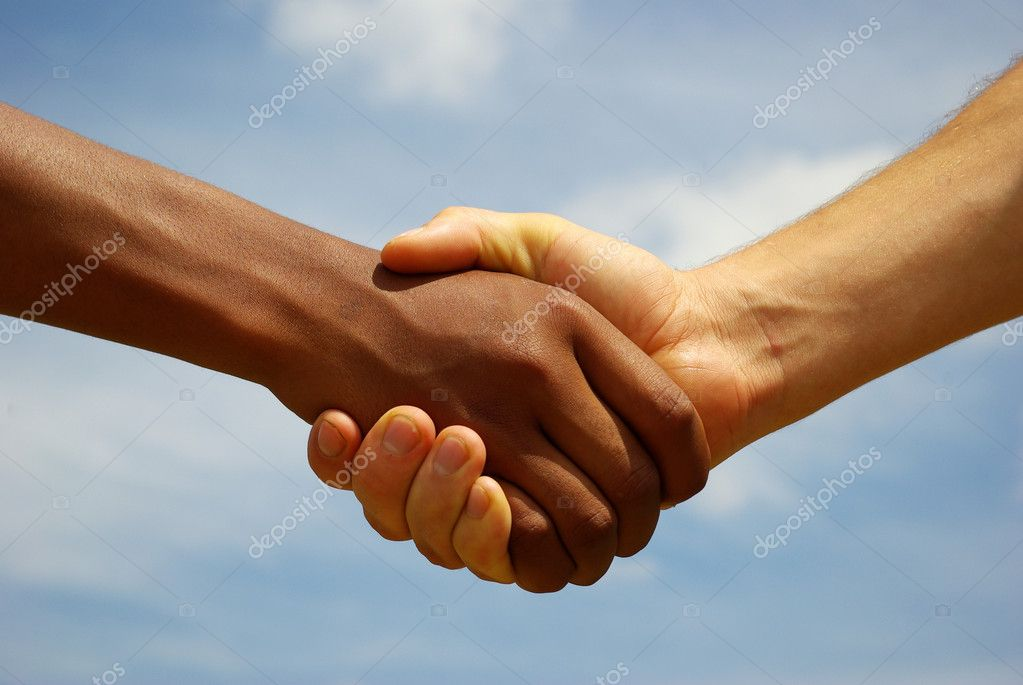 Two young businessmen shaking hands — Stock Photo #2119794
