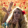 Barefoot blonde in poppies — Stock Photo #1007494