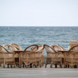 Stock Photo: Rattan Chairs Bar Empty on Beach