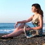 Beautiful Young Lady Sitting on Pebble — Stock Photo