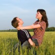 Teen Couple Embrasing in Field — Stock Photo #1072177