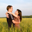 Stock Photo: Teen Couple Embrasing in Field