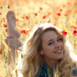 Barefoot blonde in poppies — Stock Photo #1072540