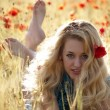 Royalty-Free Stock Photo: Barefoot blonde in poppies