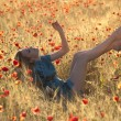 Barefoot blonde in poppies - Stock Photo