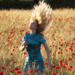 Blonde in poppy field — Stock Photo