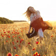 Blonde walking in poppy field — Stock Photo #1072884