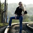 Young woman staying on railway — Stok fotoğraf
