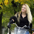 Young woman on bicylce — Stock Photo