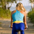 Royalty-Free Stock Photo: Female cyclist rear view