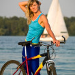 Female cyclist posing outdoors — Stock Photo