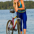 Royalty-Free Stock Photo: Female cyclist posing outdoors
