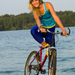 Female cyclist posing outdoors — Stock Photo #1077949
