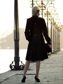 Beautiful blonde on promenade — Stock Photo