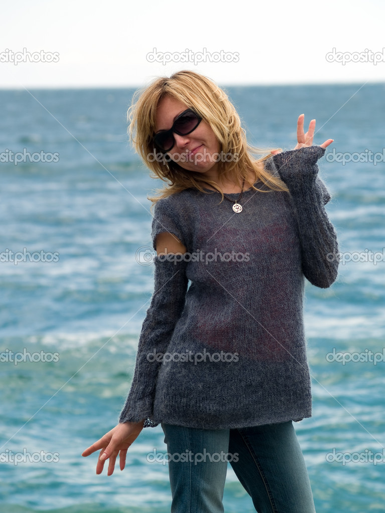 Blond Model in Hood Posing beach in Sunglasses — Stock Photo #1071735