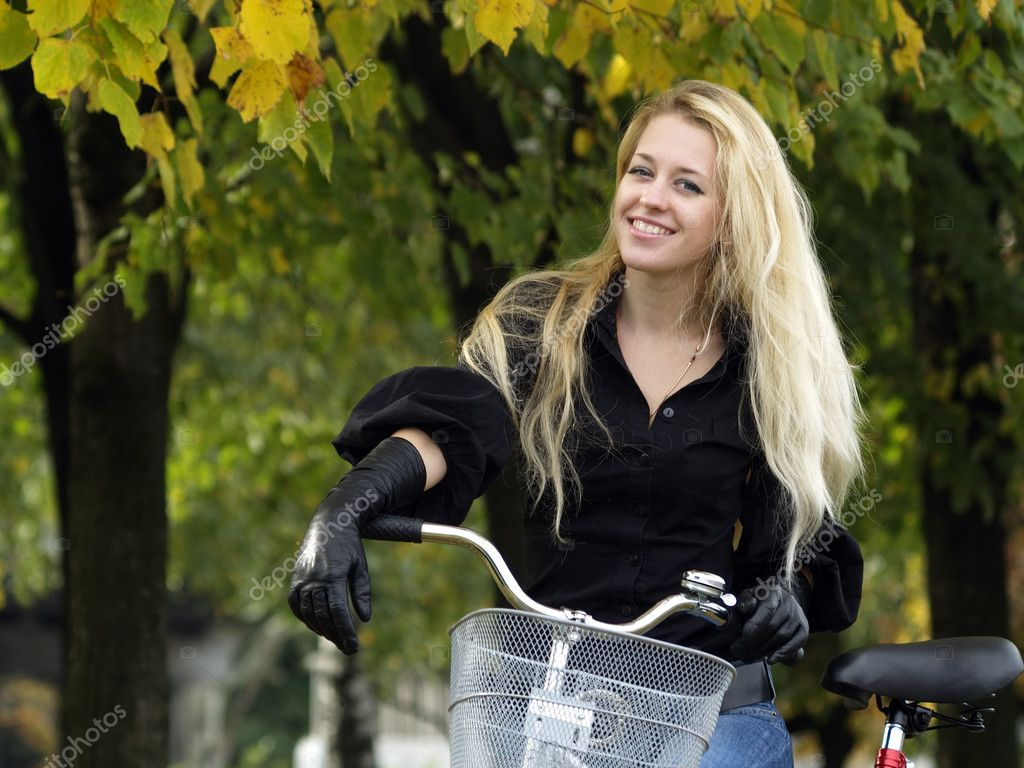 Young beautiful blond woman on bicycle under maple tree. Fall — Foto de Stock   #1075988