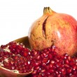 Stock Photo: Pomegranate with seeds isolated