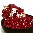 Piece of pomegranate on white — Stock Photo #1025716