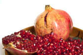 Pomegranate with seeds isolated — Stock Photo