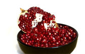 Piece of pomegranate on white — Stock Photo