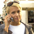 Stock Photo: Blond womtalking by telephone