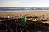 Bottle on the beach — Zdjęcie stockowe