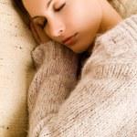 Beautiful woman lying and sleep — Stock Photo