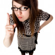Young girl with glasses shows a finger — Stockfoto