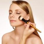 Woman applying make up. — Stock Photo