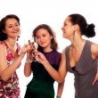 Three Young Women Enjoying Champagne — Stock Photo